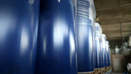 Stock Video Footage of New blue barrels inside a storage warehouse. Camera slider moving.