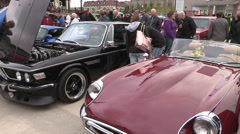 Vintage classic and performance cars on display at car show Stock Footage