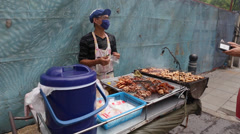 Tourist buy some food at the local market in Bangkok, Thailand. Stock Footage