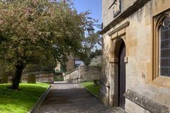 Cotswold churchyard - stock photo