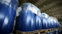 New blue barrels inside a storage warehouse. Camera slider moving. Stock Footage