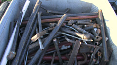 Small metal pieces thrown into pile Stock Footage