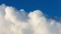 River of lumpy puffy sunny clouds on deep blue sky background. Stock Footage