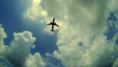 Aeroplane flying through the sky Stock Footage