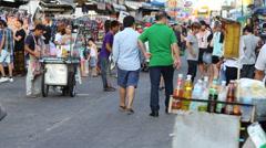 Tourists walking in Khao San Road. Bangkok, Thailand Stock Footage