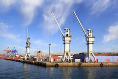 Industrial harbor with large cargo cranes Stock Photos