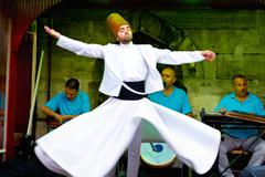 istanbul - july 25: sufi whirling dervish (semazen) dances at sultanahmet dur - stock photo