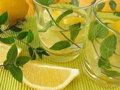 Lemonade with lemon and peppermint - stock photo