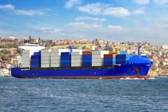 Cargo ship transporting export goods in containers to foreign countries Stock Photos