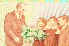 Close up of old turkish banknote (100,000 tl). ataturk with child symbolizes  Stock Photos