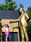 Statue of ataturk with child symbolizes the revolution of new turkish alphabe Stock Photos