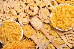 Different types of pasta. whole wheat pasta, pasta, corn, rice noodles Stock Photos