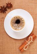 Coffee on burlap  with cinnamon and anise Stock Photos