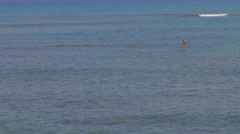 Maui - man trying to paddle board Stock Footage