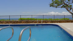 pristine Maui blue pool with ocean view - stock footage