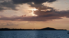 Small thai boat sails over the sea at sunset. Stock Footage