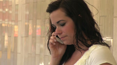 Worried and upset female on cell phone Stock Footage