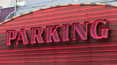 Parking neon lights sign flashing Stock Footage