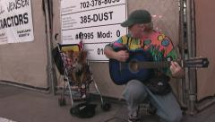 Man playing guitar on Fremont with dog Stock Footage