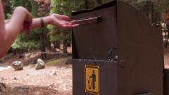 Throwing trash away in Forest 4k Stock Footage