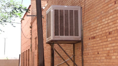 Air conditioner unit on side of industrial building Stock Footage