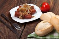 Stock Photo of fried sausage with onions.