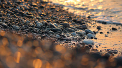 Tidal bore. Sunrise, sunset at sea waves with bokeh. Stock Footage