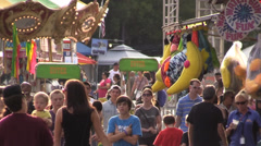 Carnival, County Fair, crowds on the midway Stock Footage