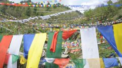 Buddhist Prayer Flags at water falls Stock Footage