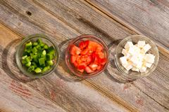 ingredients for a simple healthy greek salad - stock photo