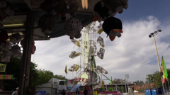 Stock Video Footage of Carnival, County Fair, game concession and ride