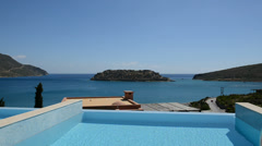 Swimming pool at luxury villa with view on Spinalonga island, Crete, Greece Stock Footage