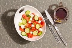 Healthy fresh feta salad with a mug of hot tea Stock Photos