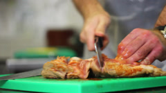 Butcher cutting meat into pieces Stock Footage