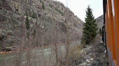 Railroad coal steam train along mountain forest river HD 140 Stock Footage