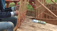 Man Weaving wickerwork Stock Footage