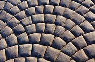Stock Photo of curved pattern of paver stones forming arcs