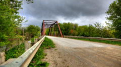 4K UltraHD Timelapse of an old iron bridge on a country road Stock Footage