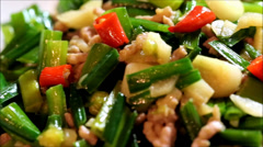 a dish called chive bud fried ground pork - stock footage