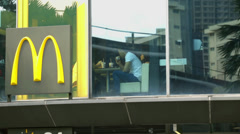 People eating at Macdonalds train reflection Stock Footage