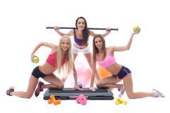 Cheerful sportswomen with gymnastic equipment Stock Photos