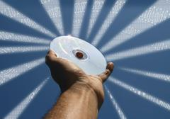 Stock Illustration of hand with cd and binary code rays