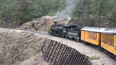 Steep mountain grade coal fired steam engine railroad HD Stock Footage