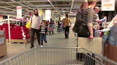 Stock Video Footage of Timelapse of camera moving through the crowd of customers in Ikea showroom