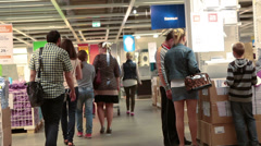 Camera moving through the crowd of customers in Ikea showroom Stock Footage
