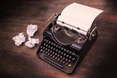 Vintage typewriter and old books Kuvituskuvat