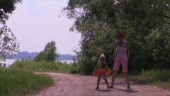 Happy little girl takes a funny dance on the river summer resort. Slow Motion. Stock Footage