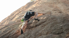 Man Rock Climbing Stock Footage