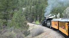 Antique vintage coal firer steam locomotive Rocky Mountains HD 169 Stock Footage