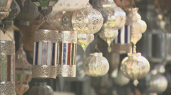 Silver lanterns hanging in a market stall, Morocco Stock Footage
